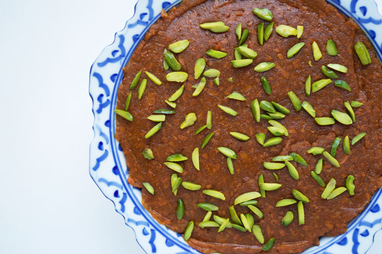 When you've spread your halva ye havij (Persian sweet carrot confection), place some crushed pistachios on top then let it cool