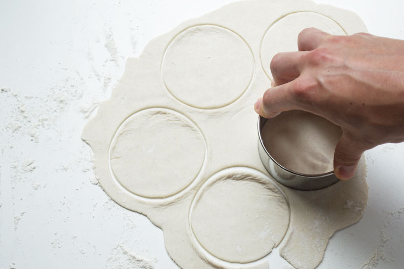 To get uniform momo dumplings, use a circular pastry cutter and cut out shapes from a flat piece of dough