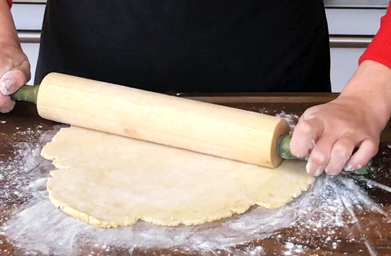You want to roll your pie crust dough to roughly 1/4 inch thickness and at least 2 inches in diameter longer than your pie plate