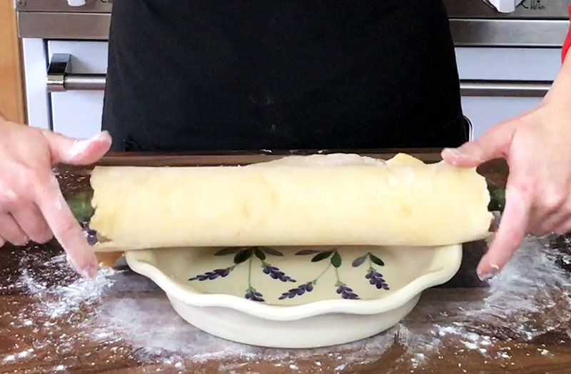 The easiest way to transfer your pie crust from your board to the pie dish is by draping it over your rolling pin