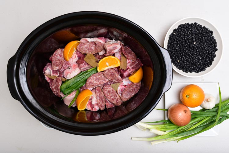 Brazilian Feijoada: Combine all ingredients for the Feijoada in a slow cooker