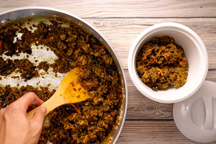 South African Bobotie: spoon into baking dish